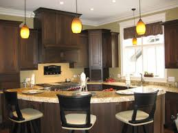 Decorating Kitchen Islands by Wood Cabinet And Two Lamp Chandelier Above Small Brown Kitchen