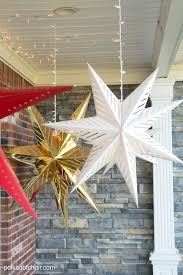 Hanging Christmas Lights by Hanging Star Lanterns A Christmas Front Porch Decorating Idea