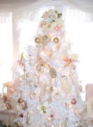 white christmas tree with silver decorations u2013 happy holidays