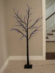 black tree with purple lights festival collections