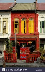 Chinese Home Red Chinese Terrace Or Terraced House With Yellow Shutters