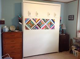 murphy bed in the sewing with the front as a design wall sewing