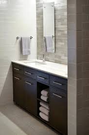 white shower areas with transparent glass added by brown wooden