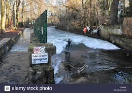 river surfer in the english garden park winter in munich bavaria