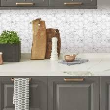 white kitchen cabinets with hexagon backsplash roommates til4245flt carrara marble hexagon peel and stick tile white black