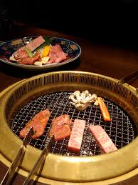 japanese restaurant cook at table yakiniku order cuts of meat and veggies cook yourself over coal or