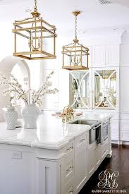 Visual Comfort Island Light White Island With Gilded Iron Lanterns Transitional Kitchen
