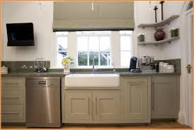 new taupe kitchen cabinets on l shape with great stove on its