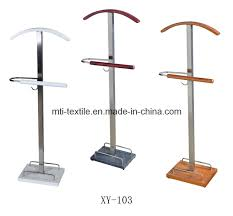 furniture red wooden standing coat rack with four hooks on gray