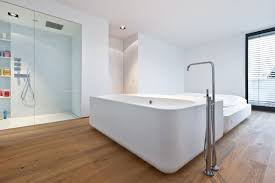 decor cozy bathtub with graff faucets on floor and decor