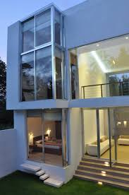 Minimalism Design Architecture Glass Wall And Window With Metal Frames Design Green