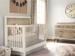 baby nursery room with white furniture including convertible crib