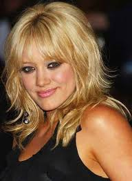 above shoulder tapered around face hairstyle hilary duff s shaggy layers and long bangs give her a funky rock