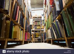 very old library in a bad condition books on shelves ladder at