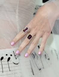 a close up of katy perry u0027s hand adorned in ivy new york spinel