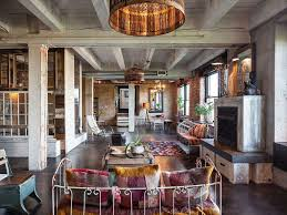 eclectic living room with exposed beam u0026 concrete floors in