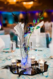 Cylinder Vase Centerpiece by Minimalist Diy Centerpiece Feathers And Piece Of Greenery In