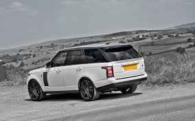 white land rover white a kahn design land rover range rover by the road side