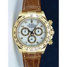 golden rolex rolex cosmograph daytona gold white arabic tan strap 116518 rehaut