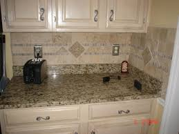 tile backsplash with laminate countertop floor to ceiling cabinets