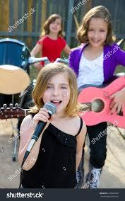 blond kid singer singing playing stock photo 148566020