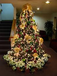 tree decorated with gold bows and white lights