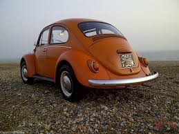 orange volkswagen beetle vw beetle 1971 1200 stock example presented in factory l20d