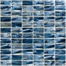 sky blue glass subway tile backsplash in modern white kitchen with