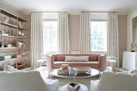 gold and pink living room with brass etagere contemporary