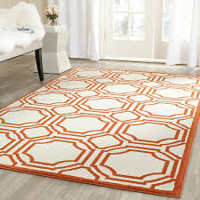 Easy Living Indoor Outdoor Rug Amazon Com Safavieh Amherst Collection Amt411f Ivory And Orange