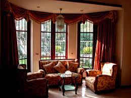 elegant modern design drapes bay window ideas with orange sofas on