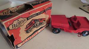 red toy jeep duncan toys company middlefield oh jumping jeep wind up toy