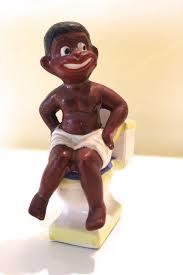 novelty salt and pepper shakers black americana child sitting on toilet novelty salt pepper