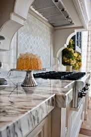 kitchen cabinet interiors interior calacatta marble kitchen top with black stoves white