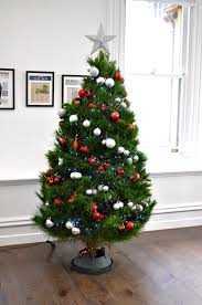 christmas tree with white lights and red bows decorated christmas trees hire rent christmas tree christmas