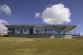 modern beach house in new zealand embraces its ocean vistas