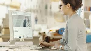 digital drawing website beautiful fashion designer sits at desk before personal