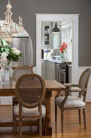 this deep gray dining room blends country and traditional styles