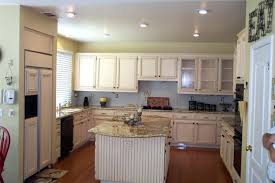 painting oak cabinets white before and after painted oak cabinet kitchen remodel and no its not white painting