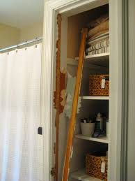 bathroom closet door ideas take the door your bathroom linen closet for a chic and open