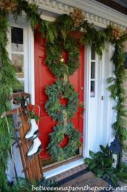 How To Decorate Garland With Ribbon 35 Christmas Door Decorating Ideas Best Decorations For Your