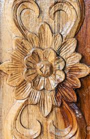 flower motifs carved on the wooden window stock photo picture and