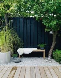 Modern Backyard Fence by Modern Garden Makeover White Pebbles Modern And Gardens