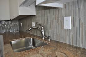 appealing glass tile back splash in bathroom with brown white
