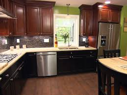 kitchen brown wood floor black cabinets brown wall cabinets