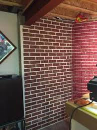 Covering Concrete Walls In Basement by This Basement Wall Is A Poured Concrete With A Brick Texture I