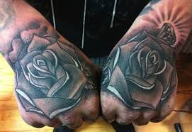old cartoon like black and white rose flowers with diamonds tattoo