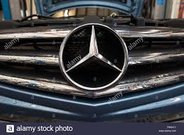 logo mercedes a mercedes car logo on the front grill stock photo royalty free