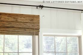 Roman Shades Over Wood Blinds Everything You Need To Know About Classic Woven Wood Blinds