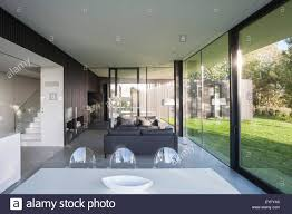 open plan living and dining area with extensive glazing living